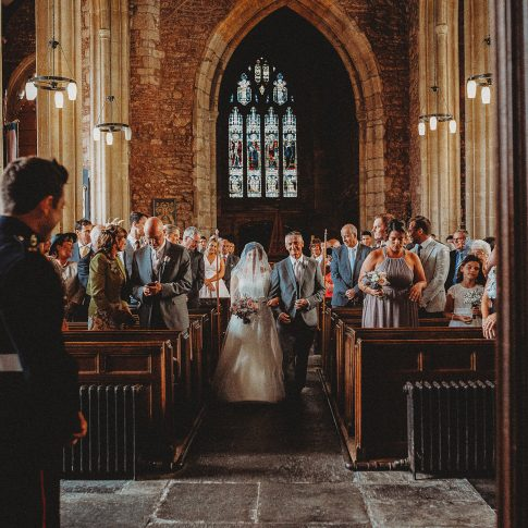 Somerset wedding photographer captures bride walking aisle