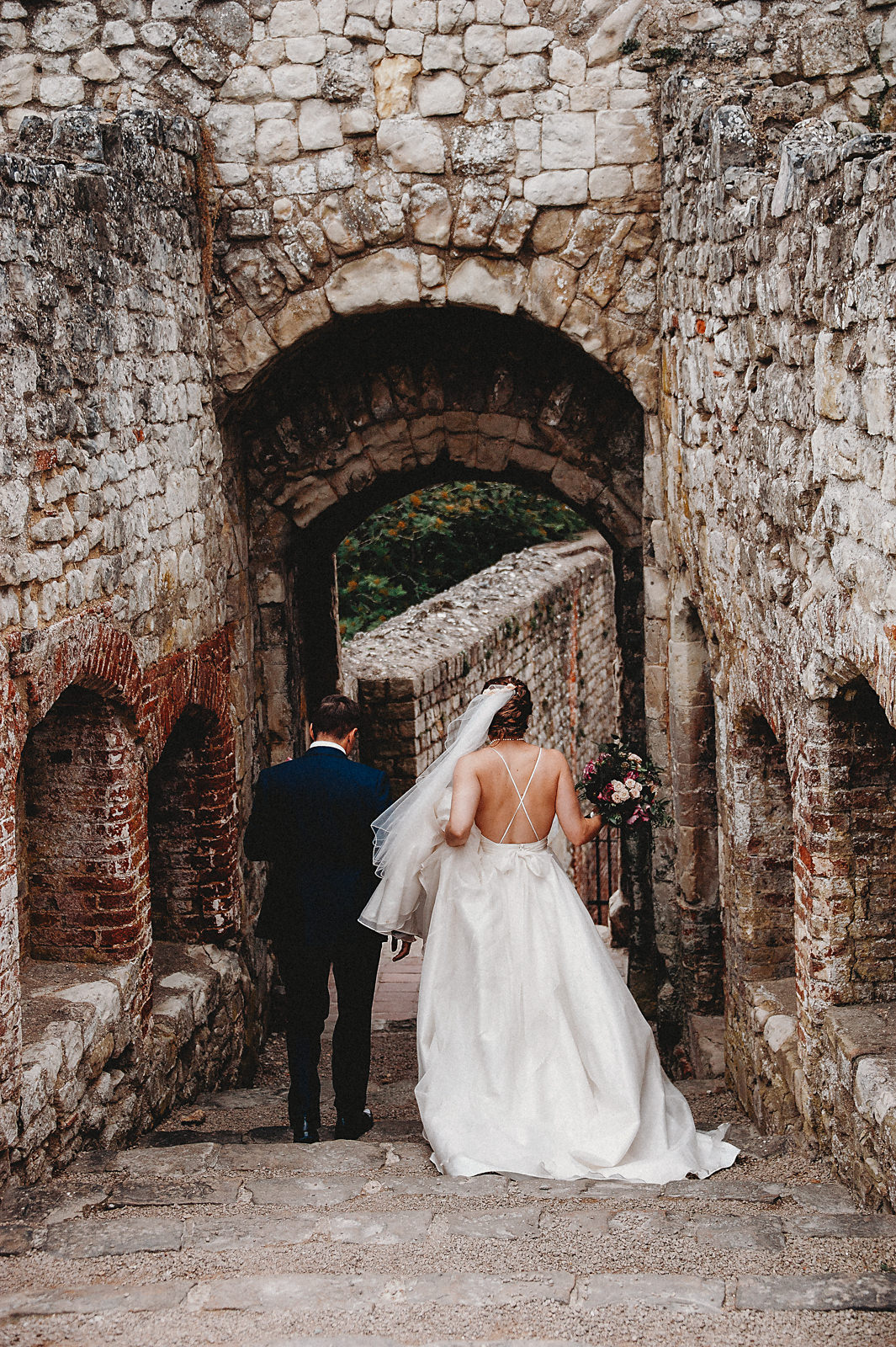 Back of Sassi Holford wedding dress bride and groom
