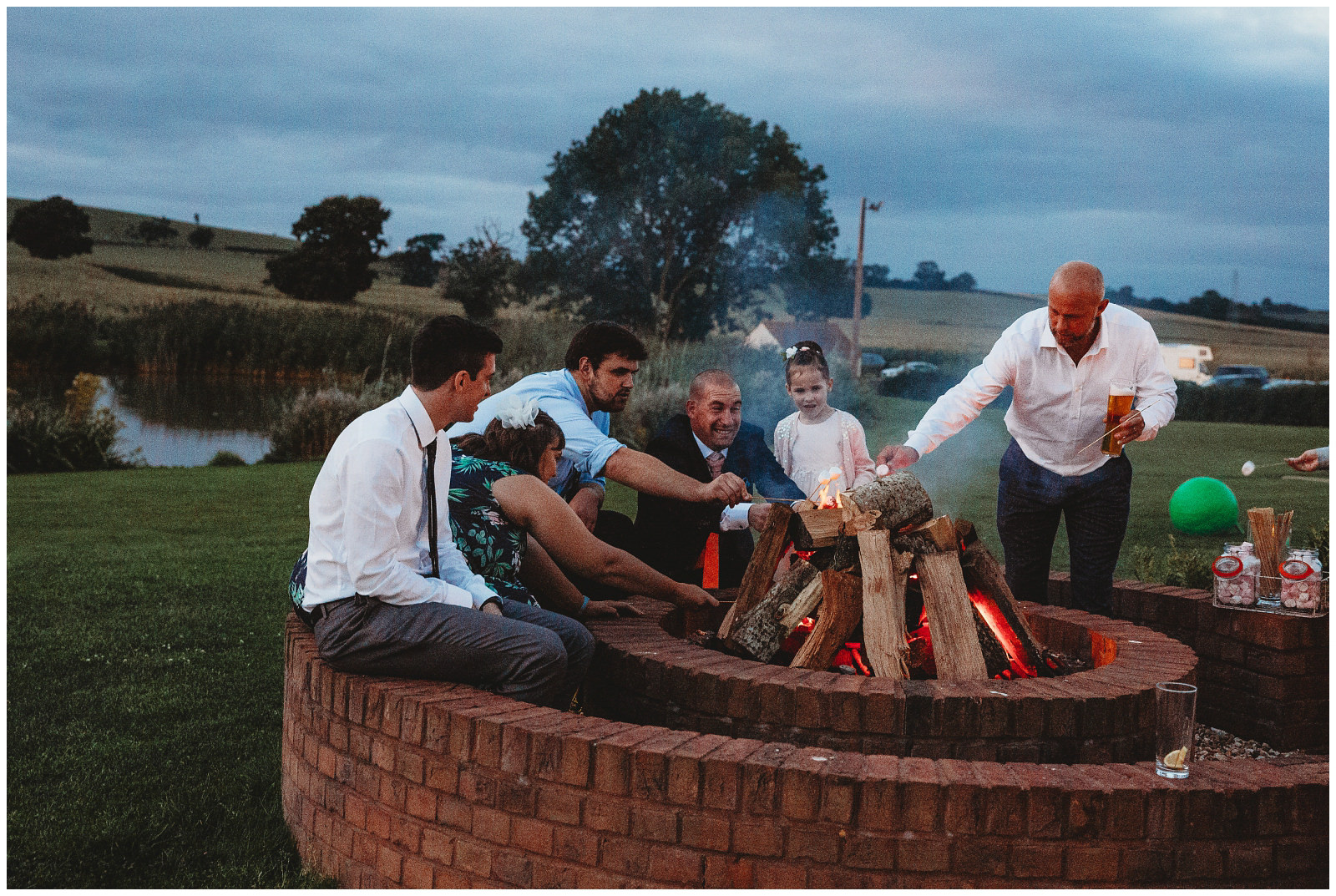 guests around firepit at quantocks lakes